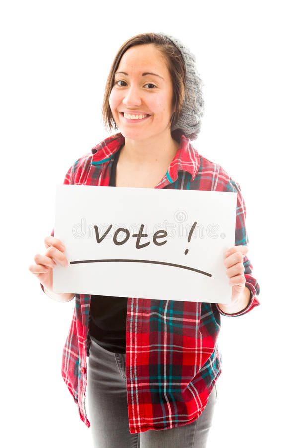 Young woman showing vote sign on white background. Young adult caucasian woman isolated on a white background stock photo