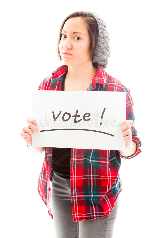Young woman showing vote sign on white background. Young adult caucasian woman isolated on a white background stock photos