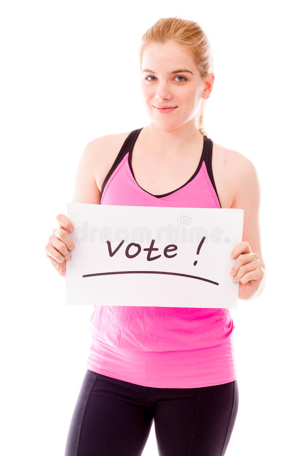 Young woman showing vote sign on white background. Young adult caucasian woman isolated on a white background royalty free stock photo