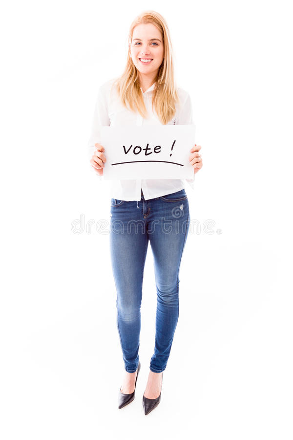 Young woman showing vote sign on white background. Young adult caucasian woman isolated on a white background royalty free stock photography