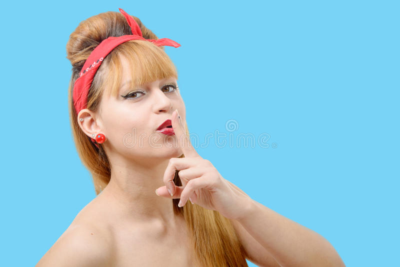 Young woman shows silence finger to his mouth stock images