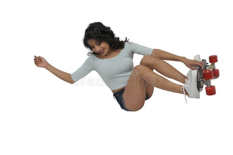 Woman riding skateboard stock photos