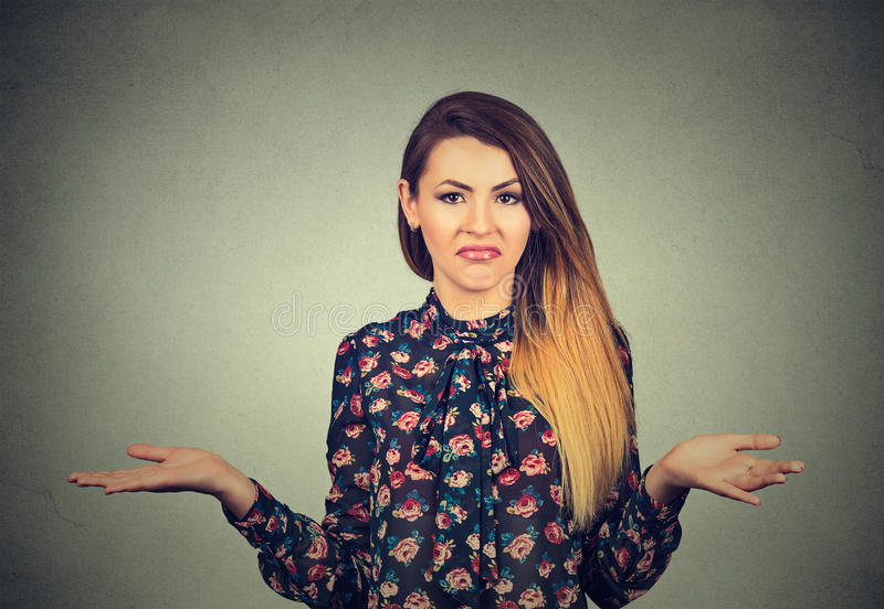 Young woman shrugging shoulders stock images