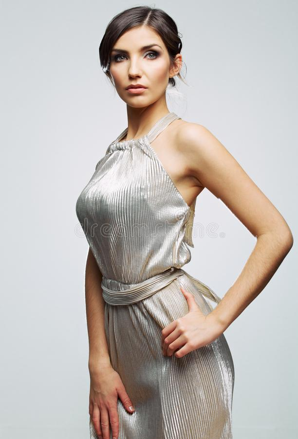 Young woman silver dress wearing. stock photos