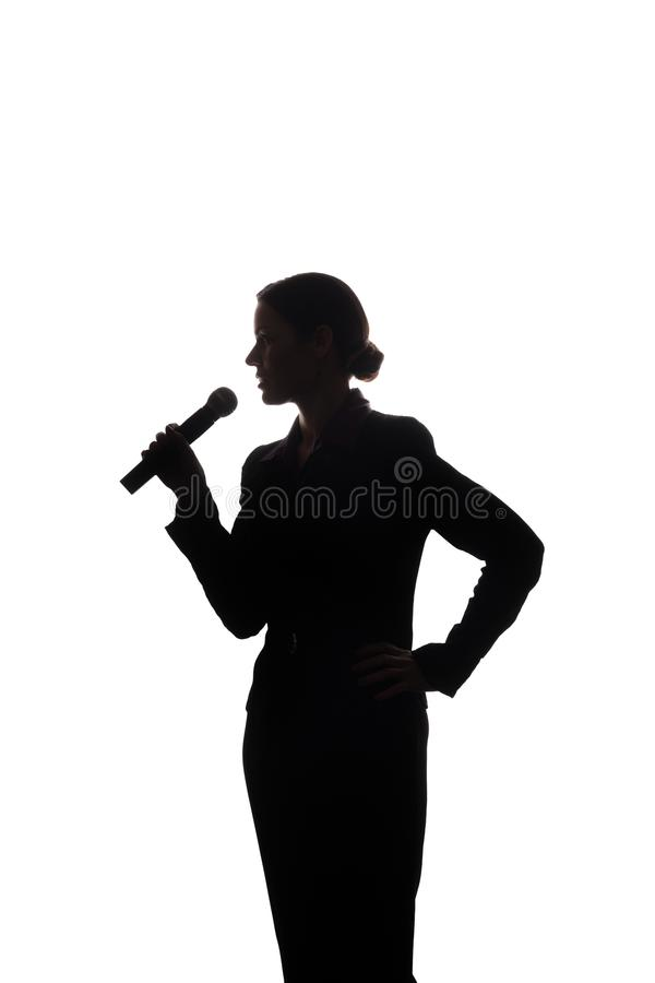Young woman singing into the microphone royalty free stock photo
