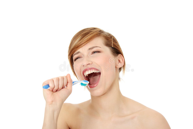 Young woman singing to tooth brush stock images