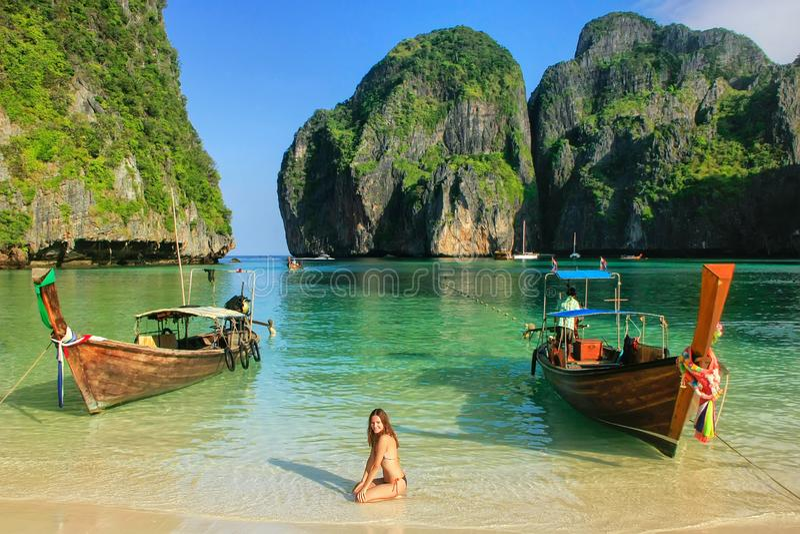 Young woman sitting on the beach at  Maya Bay on Phi Phi Leh Island, Krabi Province, Thailand. Koh Phi Phi Leh is part of Mu Ko Phi Phi National Park stock photos