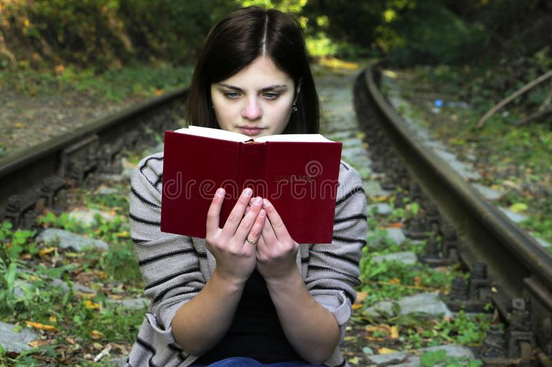 Young Woman Sitting on Bench in Park stock image