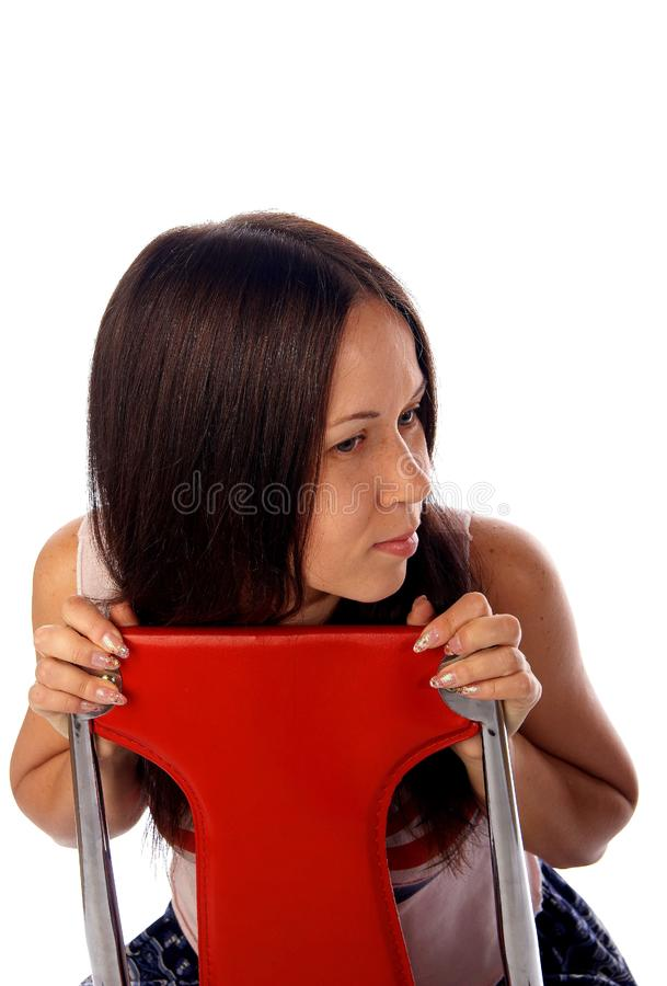 Download Young Woman Is Sitting On The Chair Stock Photo - Image of haired, cute: 7764818