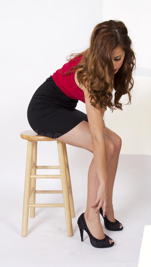 Young Woman Sitting On A Chair stock image