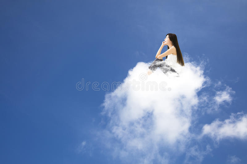 Young woman sitting on cloud and thinking stock photos