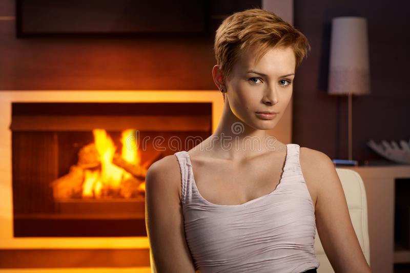 Download Young Woman Sitting By Fireplace Stock Photo - Image: 26496306