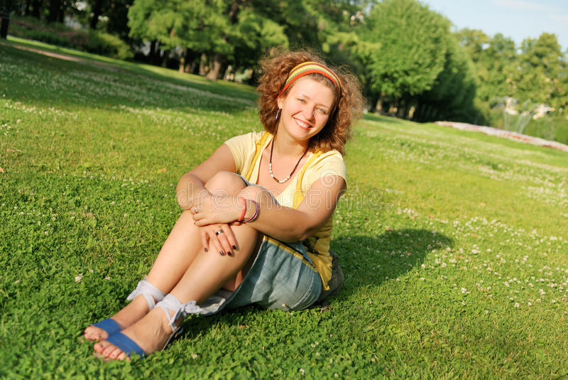 Download Young Woman Sitting On Grass Stock Photo - Image: 11196450