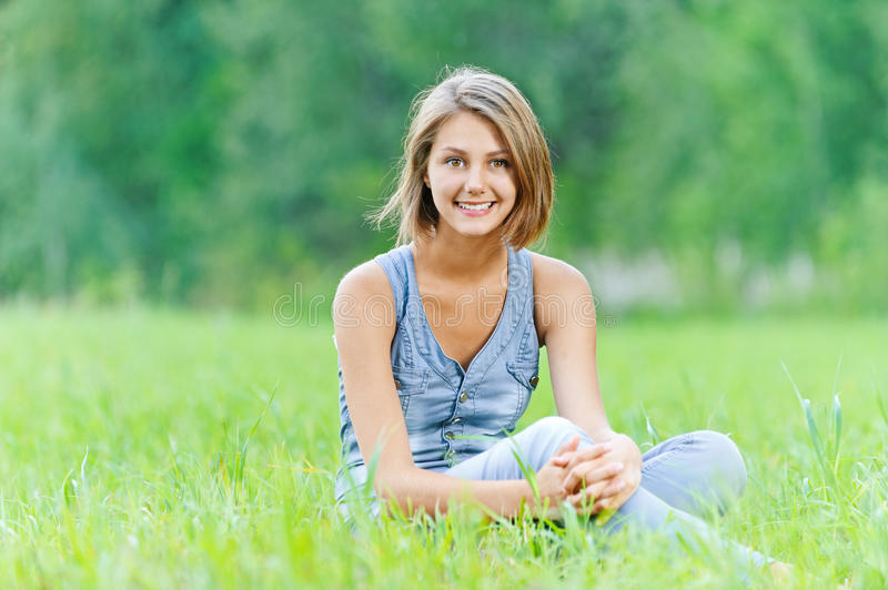 Download Young woman sitting grass stock photo. Image of attractive - 31742686