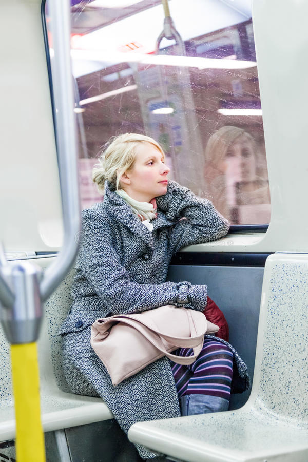 Young Woman Sitting inside a Metro Wagon stock image