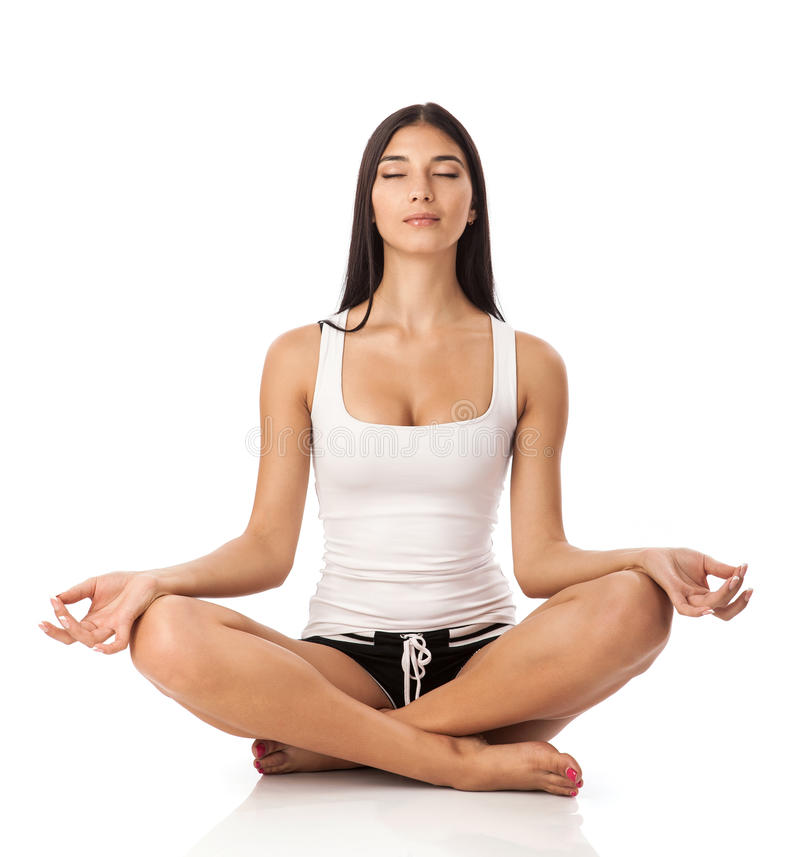 Young woman sitting in lotus position. Over white royalty free stock photos
