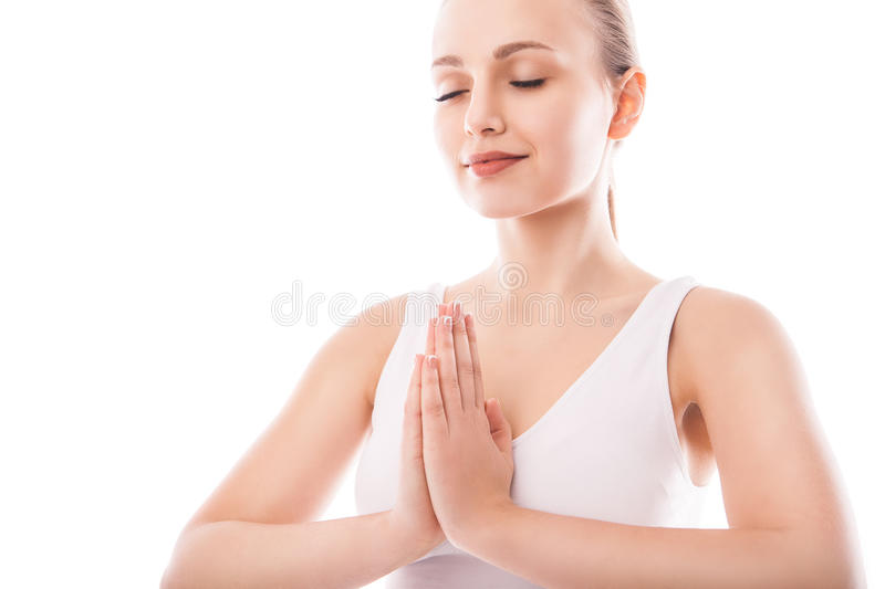Young woman sitting in lotus position isolated. Over white background royalty free stock photography