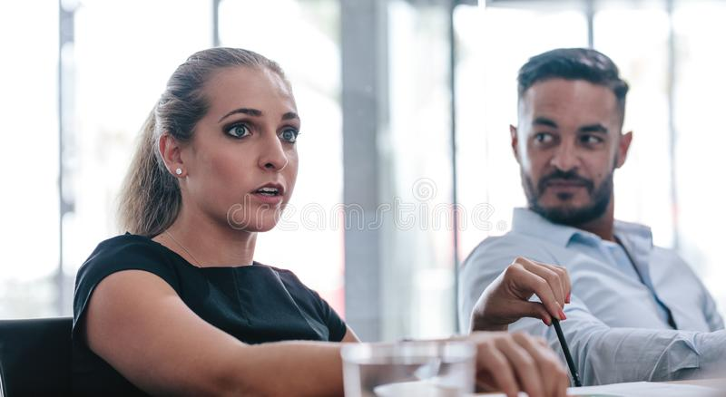 Female executive talking in strategy meeting royalty free stock photos