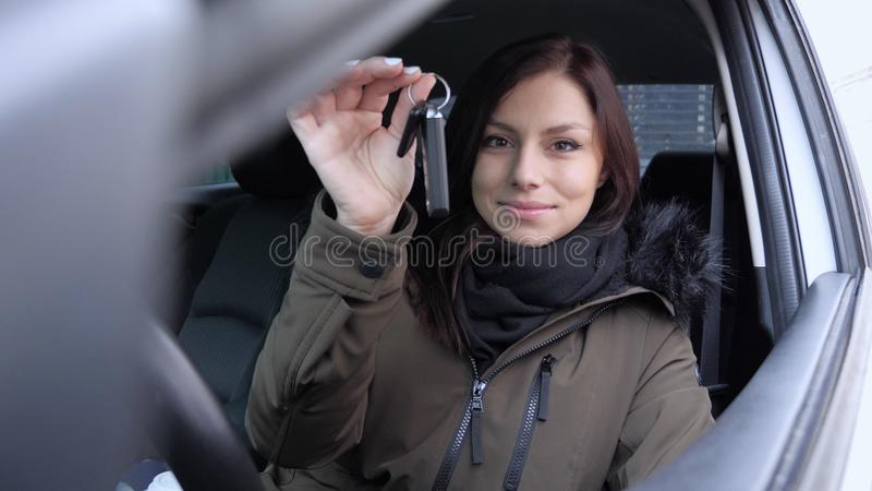 Young Woman Sitting in New Car Showing Car Keys stock photography