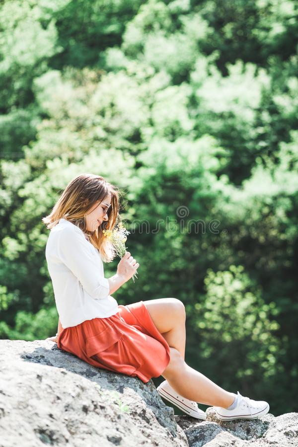 Young woman holding flowers in her hands royalty free stock photos
