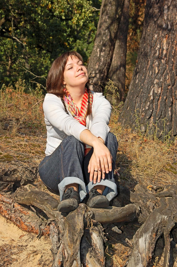 Download Young Woman Sitting On Root Stock Image - Image of countryside, optimistic: 23876333