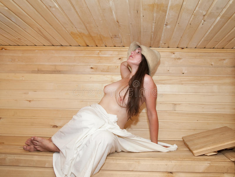 Nude women sitting sauna