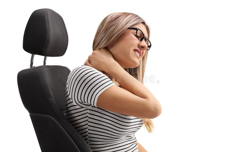 Young woman sitting in a seat and experiencing neck pain. Isolated on white background royalty free stock photo
