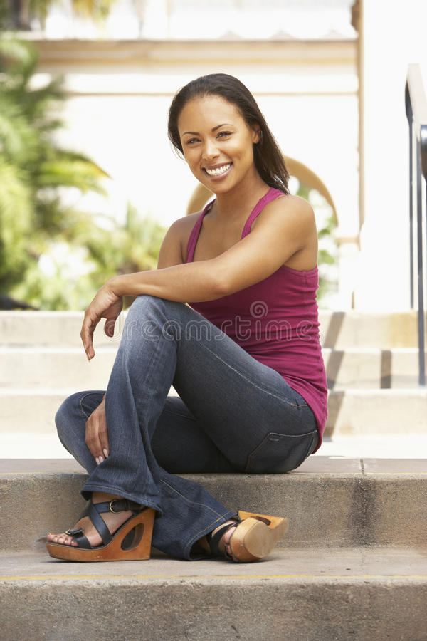 Young Woman Sitting On Steps Of Building royalty free stock photos