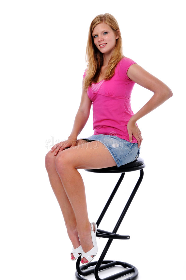 Young Woman Sitting on Stool stock photos