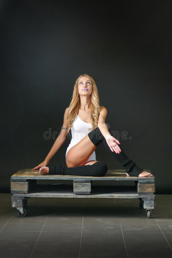 Young woman with puppy in yoga pose royalty free stock photos