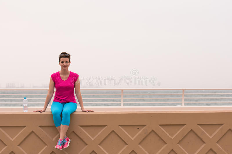 Young woman sitting after a successful training run royalty free stock photography