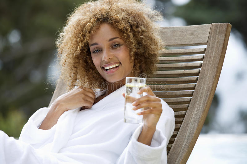 A young woman sitting on a sun lounger stock photo