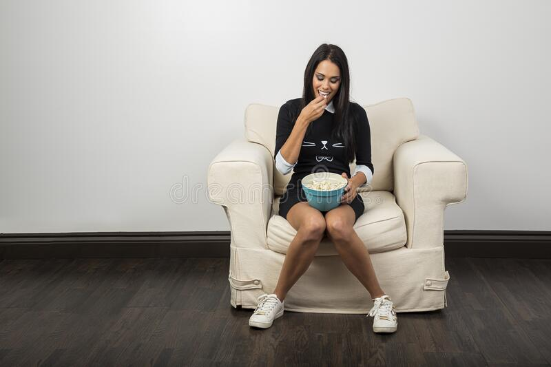 Eating popcorn from a bowl royalty free stock images