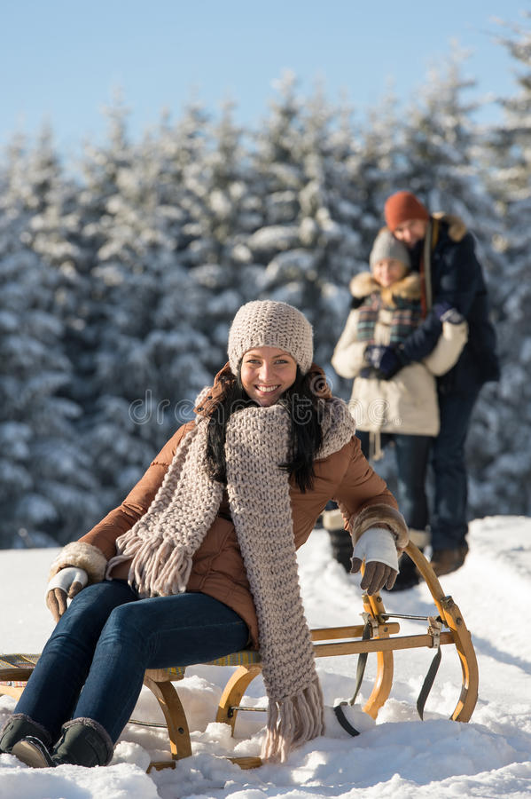 Young woman sitting winter wooden sledge royalty free stock images