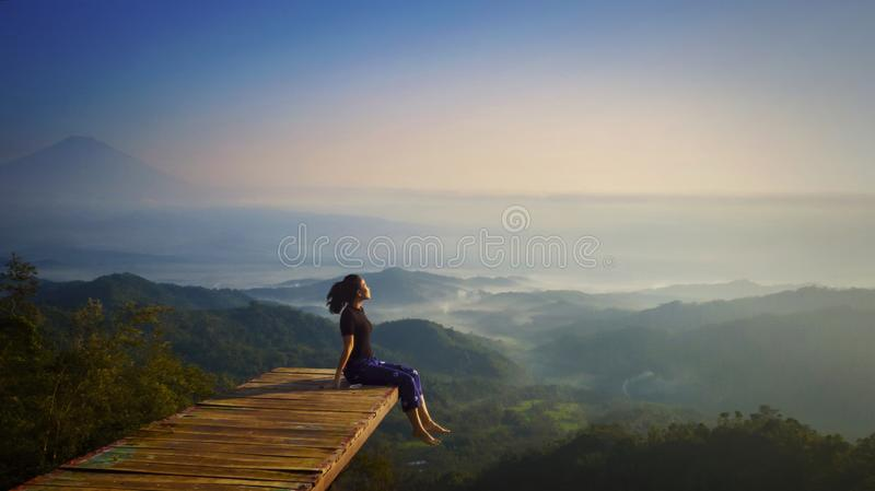 Young woman enjoying misty morning at Ngisis hill royalty free stock image