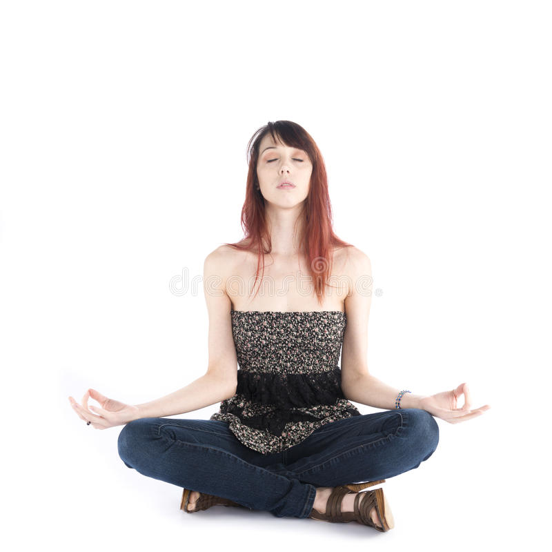 Young Woman Sitting in Yoga Pose with Eyes Closed stock photo
