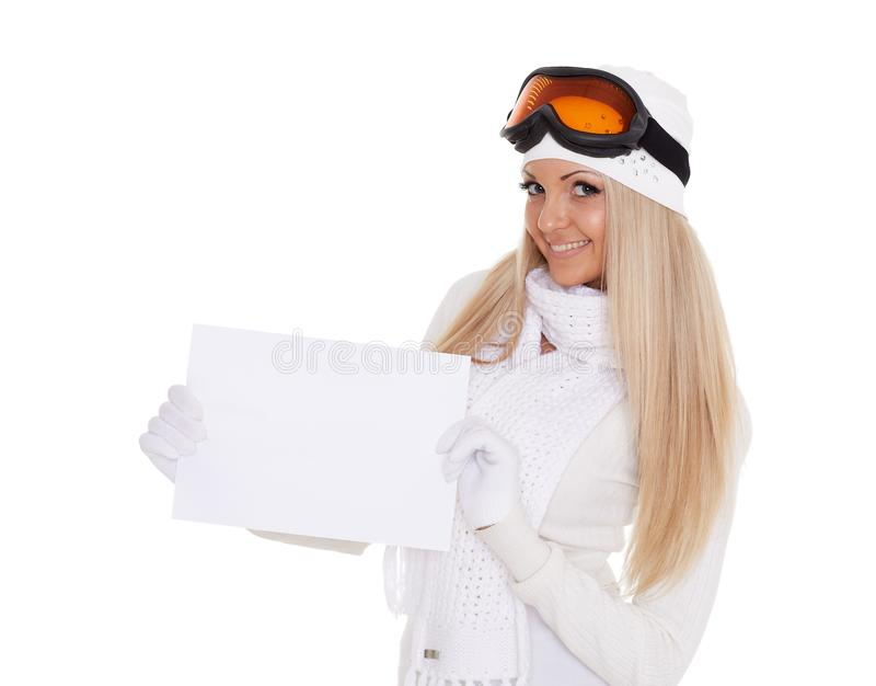 Young woman in ski glasses with empty board for the text stock image