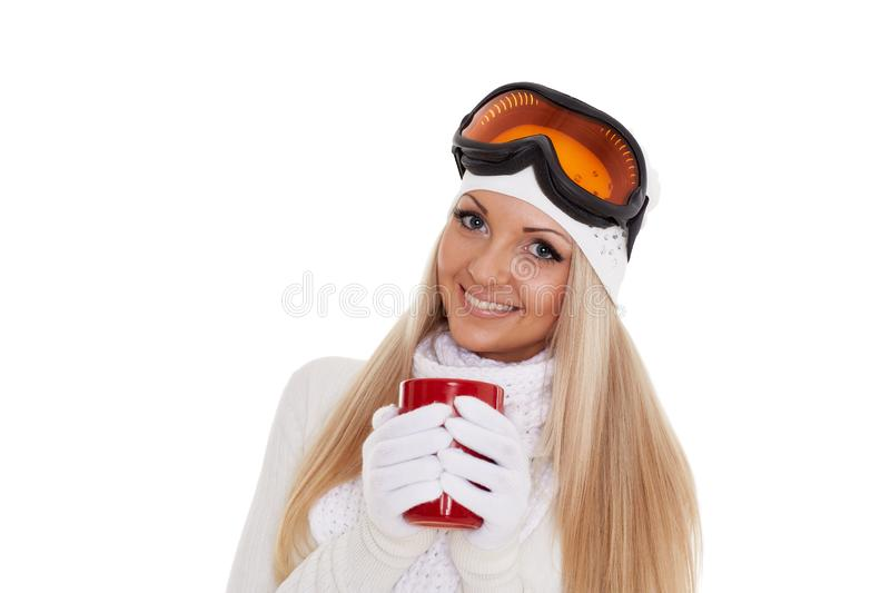 Young woman in ski glasses with red cup stock photos