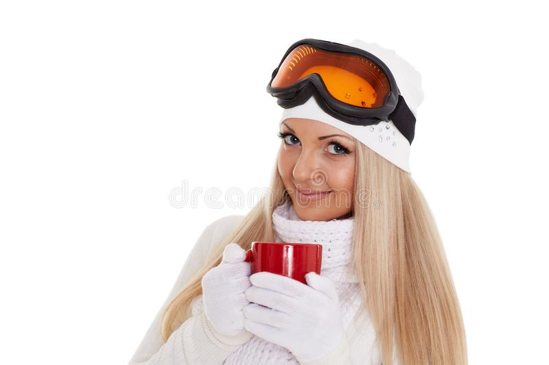 Young woman in ski glasses with red cup stock photo