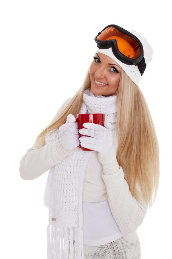 Young woman in ski glasses with red cup stock image