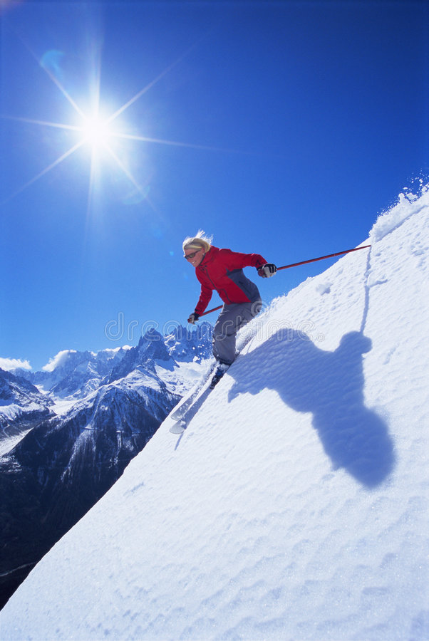 Young woman skiing stock photography
