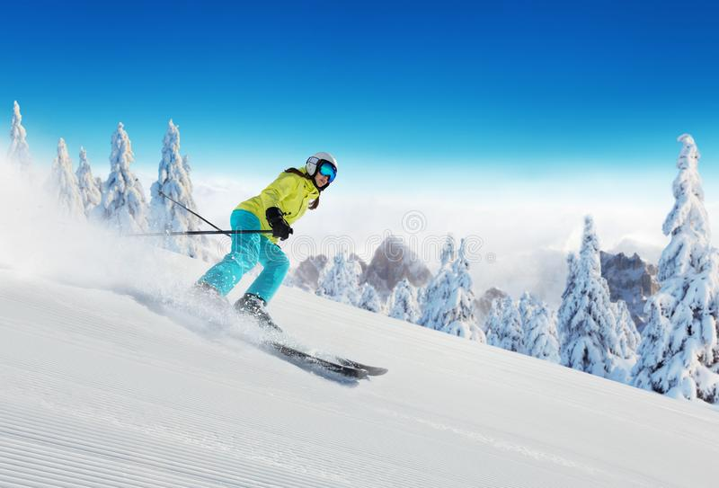 Young woman skiing in Alps royalty free stock photography
