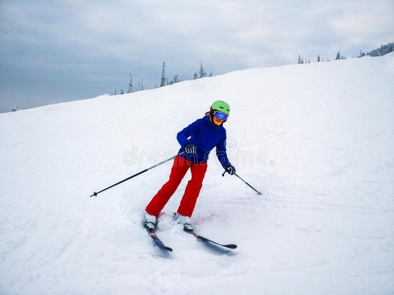 Young woman skiing fast on the slope. royalty free stock photos