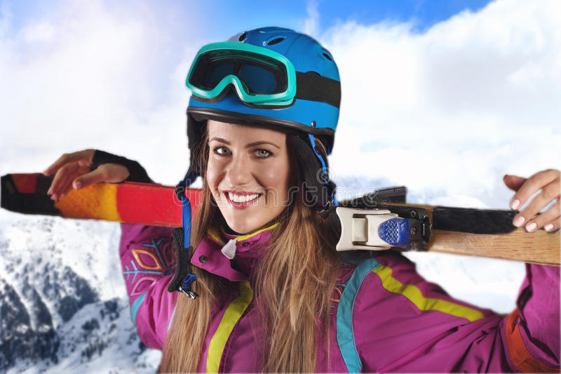 Young woman with skis. Woman with skis,in the background beautiful landscape with mountains royalty free stock photo