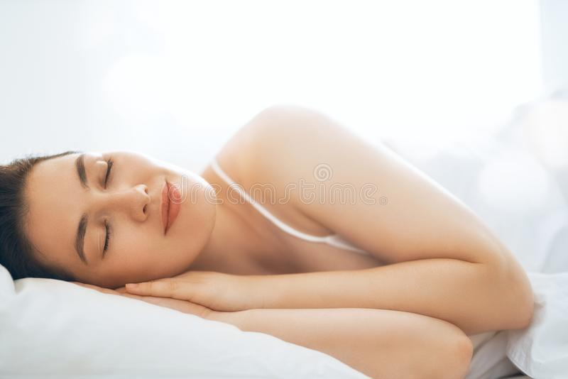 Young woman is sleeping royalty free stock photos