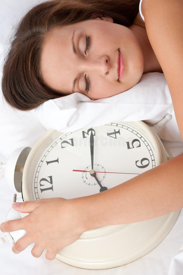 Download Young Woman Sleeping In Bed With Alarm Clock Stock Photo - Image: 10868110