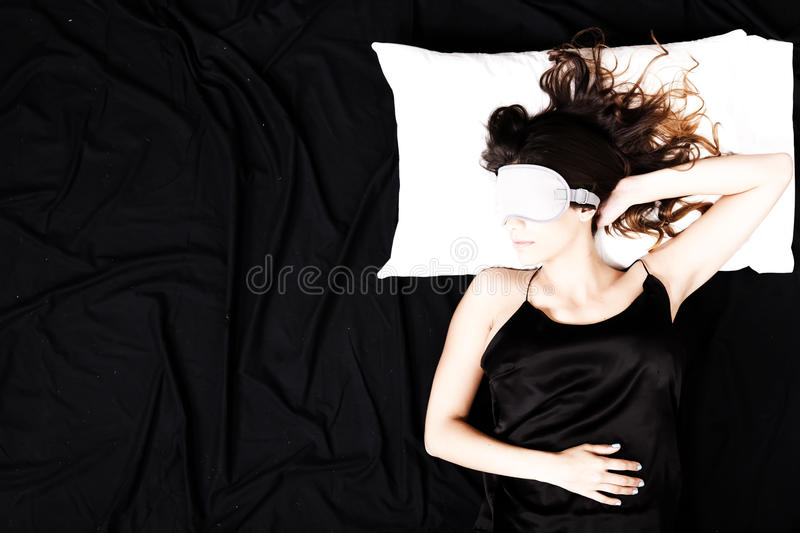 Young woman sleeping with Eyeshades. A young woman sleeping with a eye covering mask stock photo