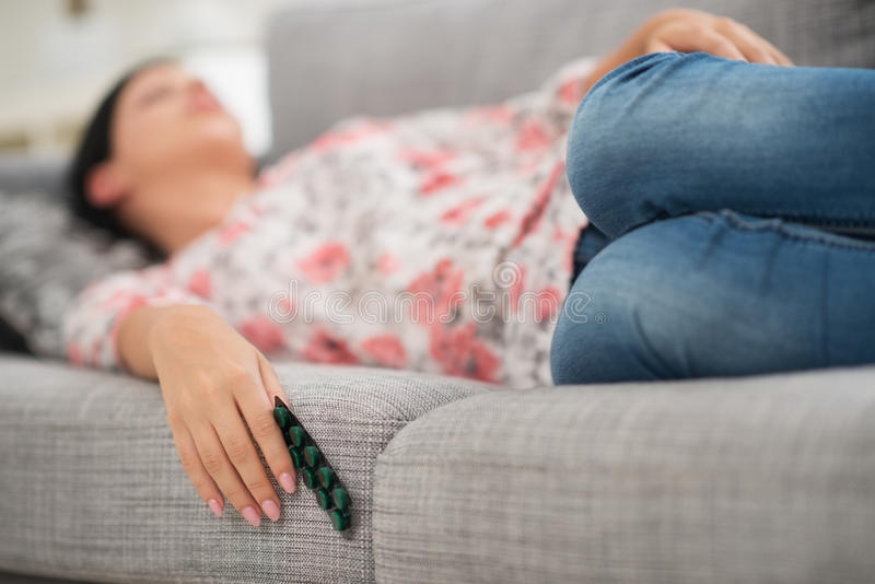 Young woman sleeping with pack of pills royalty free stock image