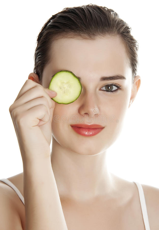 Young woman with slice of a cucumber stock photos