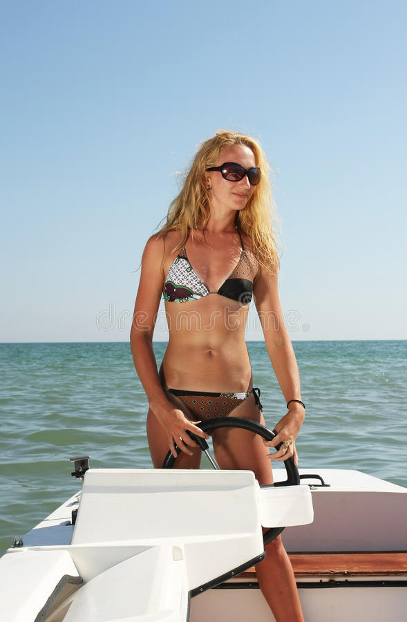 Young woman on a small boat stock photography